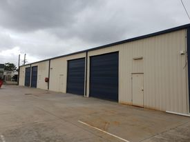 Free Standing Fully Fenced Industrial Shed With 4 Roller Doors